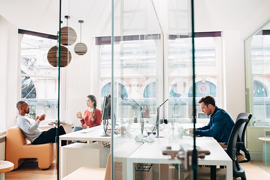 Business people working in busy office space